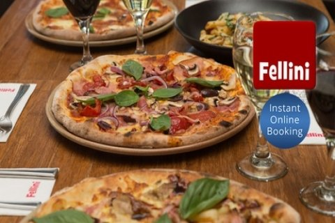 Three-Course Italian Meal with Wine for Two ($42) or Four People ($79) at Cafe Fellini...